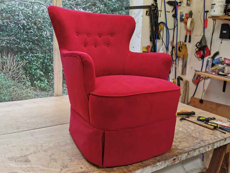 Reupholstered red arm chair