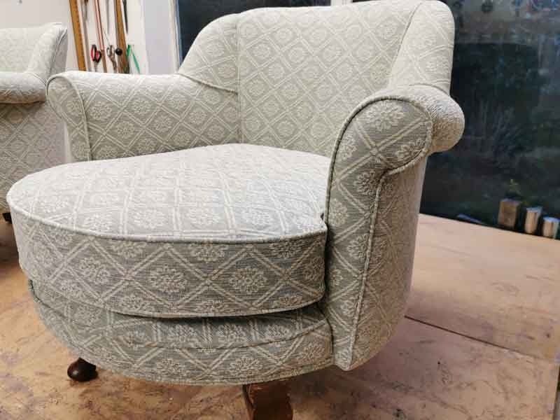 Reupholstered round arm chair
