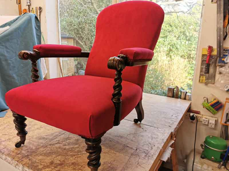 Reupholstered scarlet arm chair