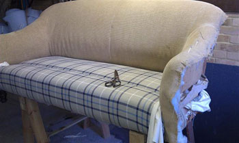 Sofa being upholstered