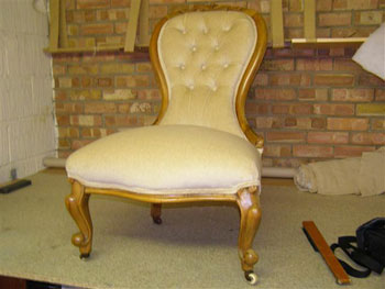 Antique chair upholstered and restored